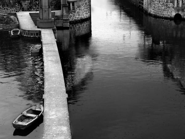 Boats in the rain.  Prague, Czech Republic-2004