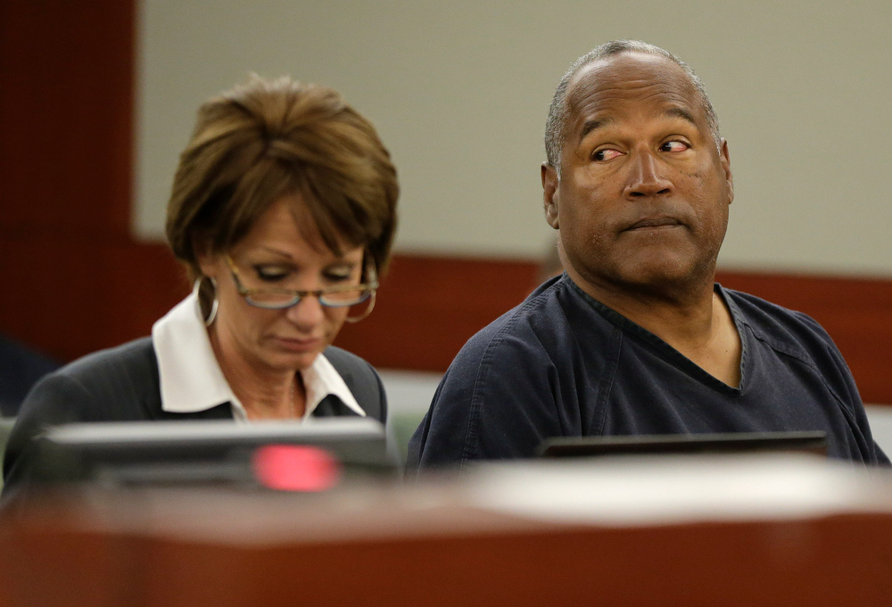 . O.J. Simpson, right, sits in Clark County District Court with his attorney, Patricia Palm, Monday, May 13, 2013 in Las Vegas. Simpson, who is currently serving a nine-to-33-year sentence in state prison as a result of his October 2008 conviction on armed robbery and kidnapping charges, is seeking a new trial, claiming that trial lawyer Yale Galanter had conflicted interests and shouldn\'t have handled Simpson\'s armed case. (AP Photo/Julie Jacobson, Pool)