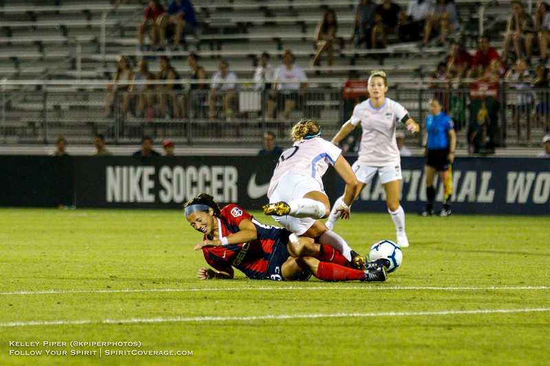 Washington Spirit forward Ashley Hatch (33) and Houston Dash midfielder Christine Nairn (10) tumble to the ground at Maureen Hendricks Field in Boyds, MD, on July 20, 2019.