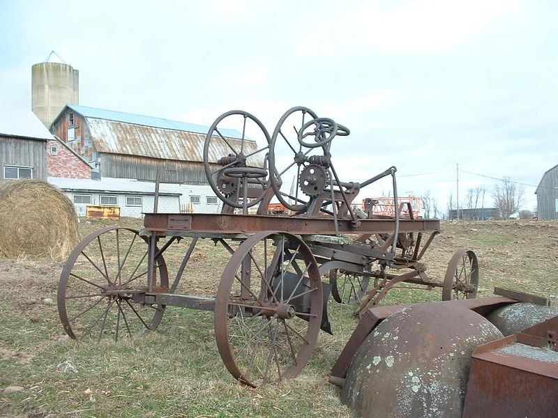 this is a horse-drawn road grader (see the blade underneath?)