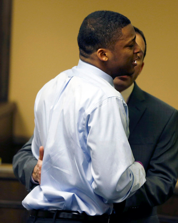 . Ma\'lik Richmond, left, is helped by Fred Abdalla Jr., chief probation officer for the Jefferson County juvenile court, as he reacts while apologizing to the victim and her family in juvenile court in Steubenville, Ohio, March 17, 2013. Trent Mays and  Richmond were found guilty of raping a 16-year-old girl at a party last summer while she was in a drunken stupor in a case that gained national exposure through social media. REUTERS/Keith Srakocic/Pool
