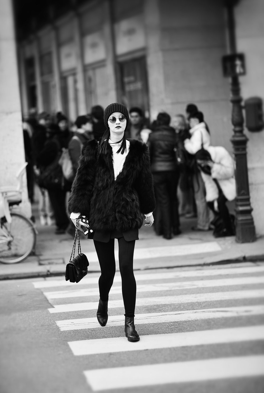Description of . A model makes her way between shows during Paris Fashion Week on March 2, 2013 in Paris, France.  (Photo by Gareth Cattermole/Getty Images)