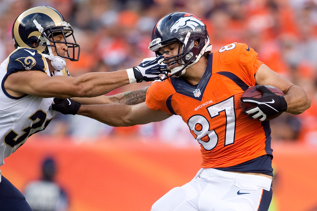 . DENVER, CO - AUGUST 24: Cortland Finnegan (31) of the St. Louis Rams grabs the face mask of Eric Decker (87) of the Denver Broncos during the first half of action of an NFL preseason game at Sports Authority Field at Mile High on August 24, 2013. This is the third game of the preseason for the Broncos. (Photo by AAron Ontiveroz/The Denver Post)