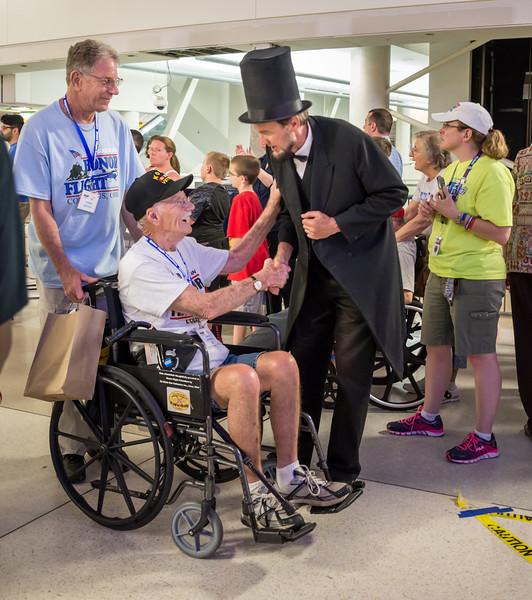 "Honor Flight's ""Abe Lincoln"" greeted each returning veteran"