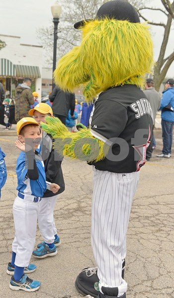 The Downers Grove Youth Baseball parade took over Main Street on Saturday