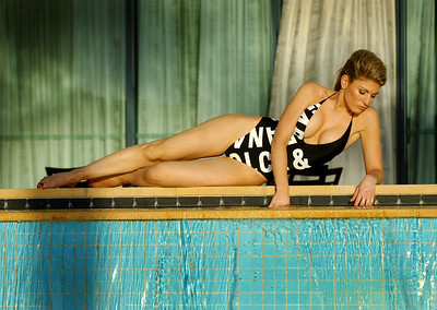 "EXCLUSIVE PICTURES - Stunning Hofit Golan relaxes around her Palazzo Versace condo pool as she waits for friend Scott Henshall to be evicted from ""I'm A Celebrity, Get Me Out Of Here"" - PHOTO: CAMERON LAIRD (Ph: 0418238811)"