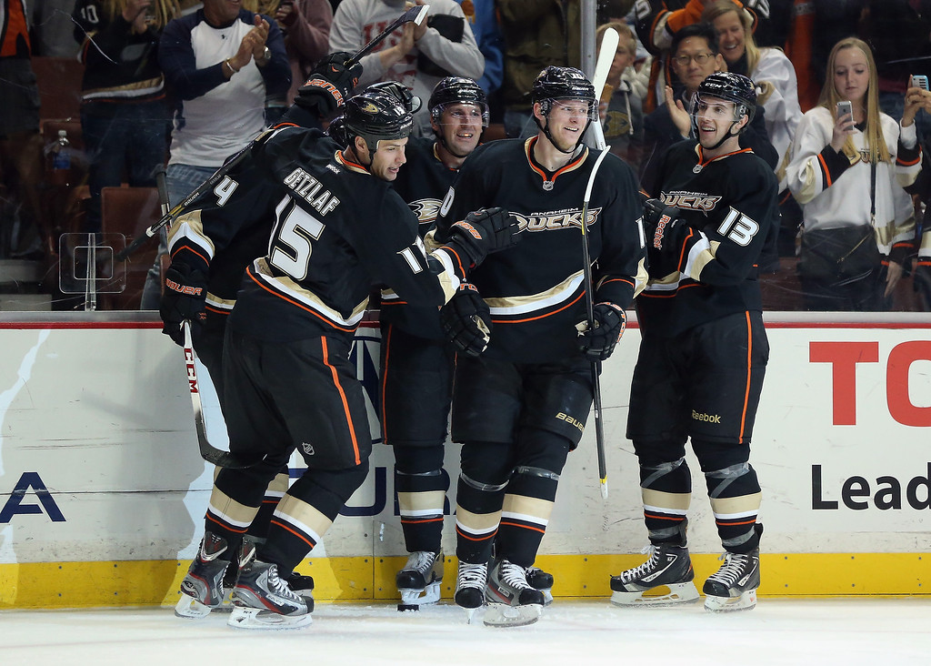 . (L-R) Ryan Getzlaf #15, Francois Beauchemin #23, Corey Perry #10 and Nick Bonino #13 of the Anaheim Ducks celebrate Getzlaf\'s goal in the third period against the Colorado Avalanche at Honda Center on February 24, 2013 in Anaheim, California. The Ducks defeated the Avalanche 4-3 in overtime.  (Photo by Jeff Gross/Getty Images)