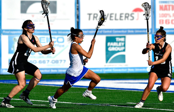 3/14/2019 Mike Orazzi | Staff CCSU's Carrisa Brown (6) and Presbyterian College's Hudson Roarick (11) and Breanne Goldfarb (13) during Thursday's women's lacrosse in New Britain.
