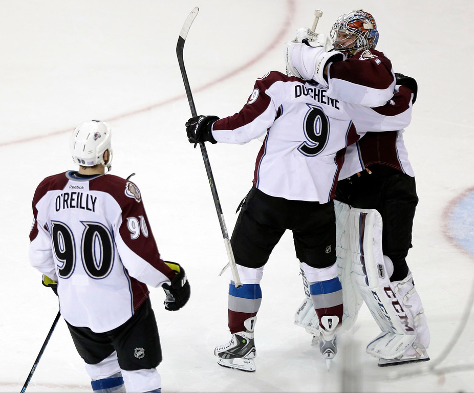 . Colorado Avalanche goalie Semyon Varlamov (1), of Russia, celebrates with Matt Duchene (9) and Ryan O\'Reilly (90) after the shootout period of an NHL hockey game Thursday, Nov. 13, 2014. The Colorado Avalanche won 4-3. (AP Photo/Frank Franklin II)