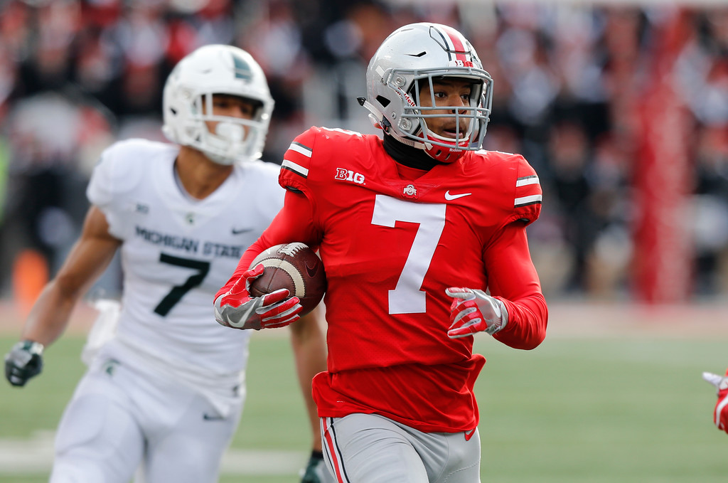 . Ohio State safety Damon Webb returns an interception against Michigan State during the second half of an NCAA college football game Saturday, Nov. 11, 2017, in Columbus, Ohio. Ohio State beat Michigan State 48-3. (AP Photo/Jay LaPrete)