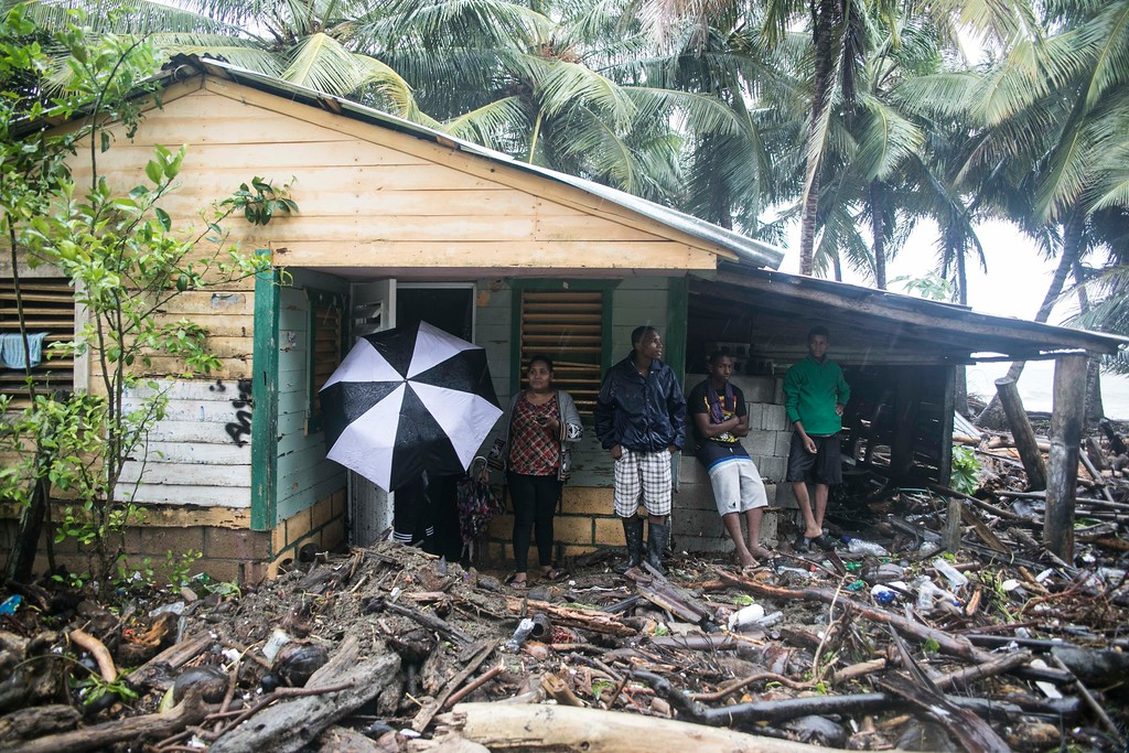 . A home is surrounded by debris brought in by Hurricane Irma in Nagua, Dominican Republic, Thursday, Sept. 7, 2017. Irma cut a path of devastation across the northern Caribbean, leaving thousands homeless after destroying buildings and uprooting trees. Irma flooded parts of the Dominican Republic when it roared by Thursday, just off the northern coast of the island it shares with Haiti. (AP Photo/Tatiana Fernandez)