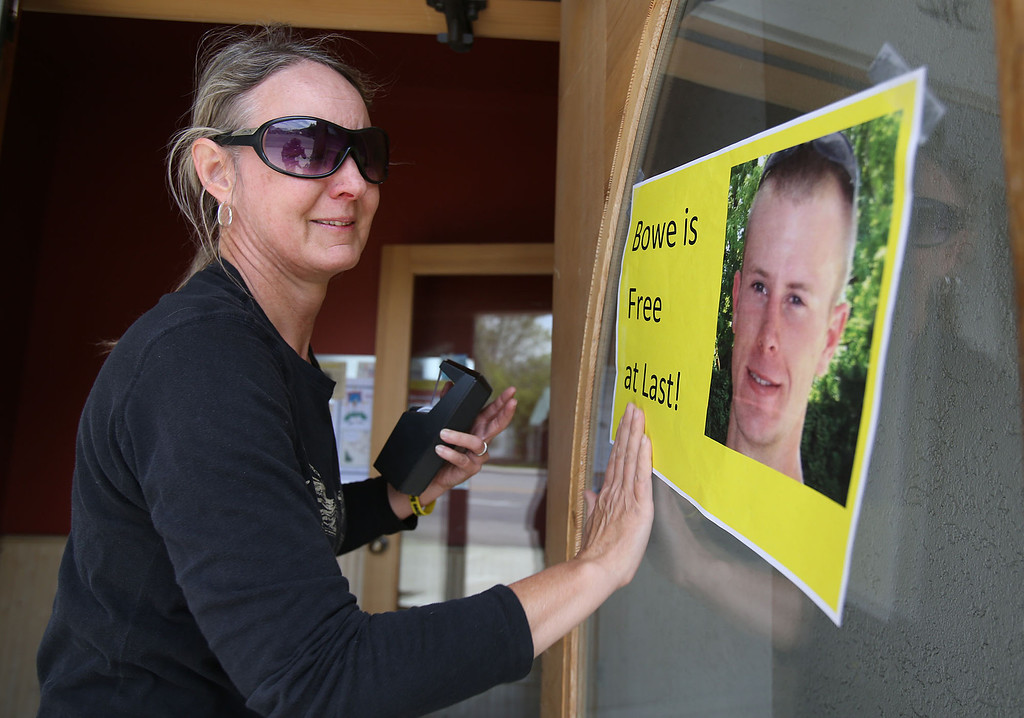 . Sondra Van Ert, co-owner of Baldy Sports, hangs a sign celebrating news of U.S. Army Sgt. Bowe Bergdahl\'s release on Saturday, May 31, 2014 in Hailey, Idaho, his hometown. Bergdahl, 28, had been held prisoner by the Taliban since June 30, 2009. He was handed over to U.S. special forces by the Taliban in exchange for the release of five Afghan detainees held by the United States. (AP Photo/The Times-News, Ashley Smith)