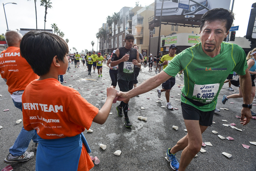 . Water is passed out to runners along Sunset blvd. in West Hollywood  during the 28th Los Angeles Marathon.  Photo by David Crane/Staff Photographer