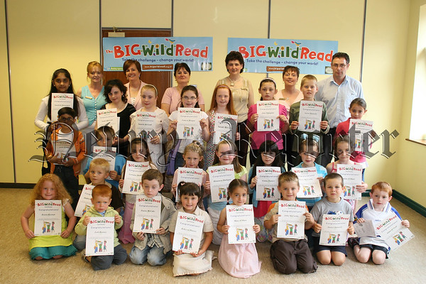 "Children who received certificates for completing ""The Big Wild Read"" in Newry Library during July & Augest, Pictured with Library Staff members Oonagh Mc Conville, Marie Mc Ateer, Marita Byrne, Siobhan Walker and Oliver Mc Geown, Also included is Catriona Ruana (minister for education) who attended as a parent. 07W37N63"