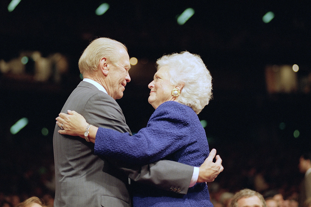 """. First lady Barbara Bush hugs former President Gerald Ford on Thursday, August 20, 1992 in Houston during Thursday evening session of the Republican National Convention in the Houston Astrodome. Earlier in an address to the convention, Ford, the last Republican to lose the White House crowned President George Bush the experience victor of the cold war and warned that the Democrats plan for change """"may be a four-year disaster."""" (AP Photo/Rick Bowmer)"""