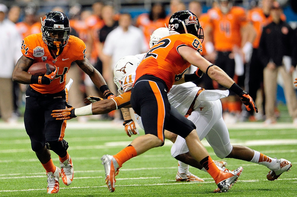 . Storm Woods #24 of the Oregon State Beavers avoids a tackle by Tevin Jackson #11 of the University of Texas Longhorns during the Valero Alamo Bowl at the Alamodome on December 29, 2012 in San Antonio, Texas.  (Photo by Stacy Revere/Getty Images)
