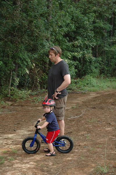 Brian's starting boy young on the bike. That's what some folks call a running bike. No cranks or pedals to get in the way - just push and roll, balance.