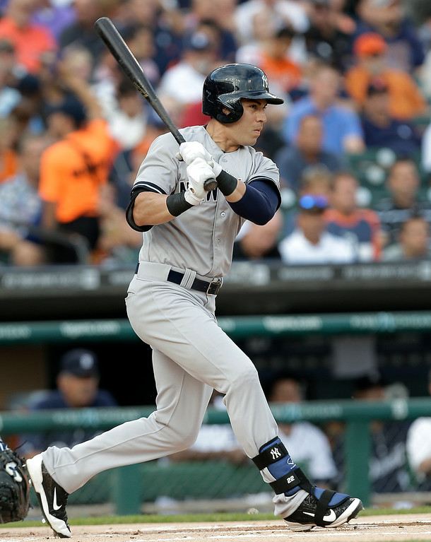 . New York Yankees\' Jacoby Ellsbury singles against the Detroit Tigers in the first inning of a baseball game in Detroit, Wednesday, Aug. 27, 2014. (AP Photo/Paul Sancya)