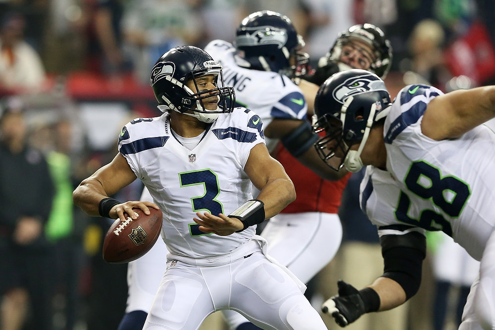 . Russell Wilson #3 of the Seattle Seahawks looks to pass against the Atlanta Falcons in the first quarter of the NFC Divisional Playoff Game at Georgia Dome on January 13, 2013 in Atlanta, Georgia.  (Photo by Streeter Lecka/Getty Images)