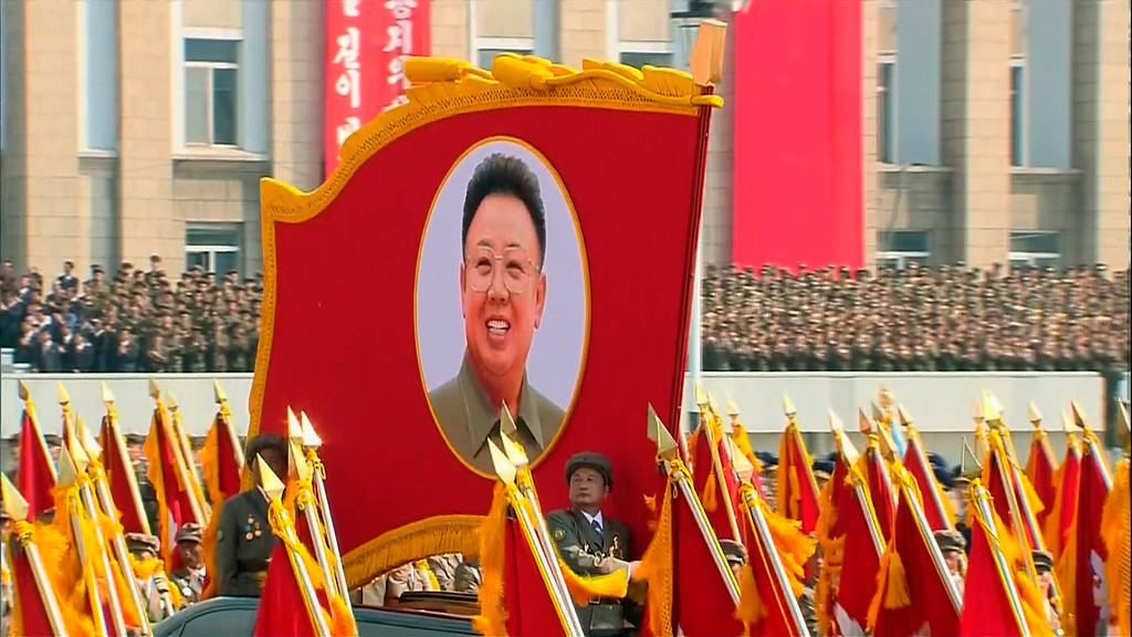 . In this image taken from video North Korean soldiers march with a portrait of the late North Korean leader Kim Jong Il during a military parade marking the 65th anniversary of the country\'s founding, Monday, Sept. 9, 2013, in Pyongyang, North Korea. (AP Photo/KRT via AP Video)
