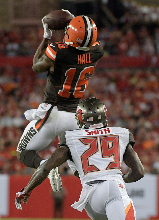. Cleveland Browns wide receiver Rannell Hall (16) makes a catch in front of Tampa Bay Buccaneers cornerback Ryan Smith during the second quarter of an NFL preseason football game Saturday, Aug. 26, 2017, in Tampa, Fla. (AP Photo/Phelan Ebenhack)
