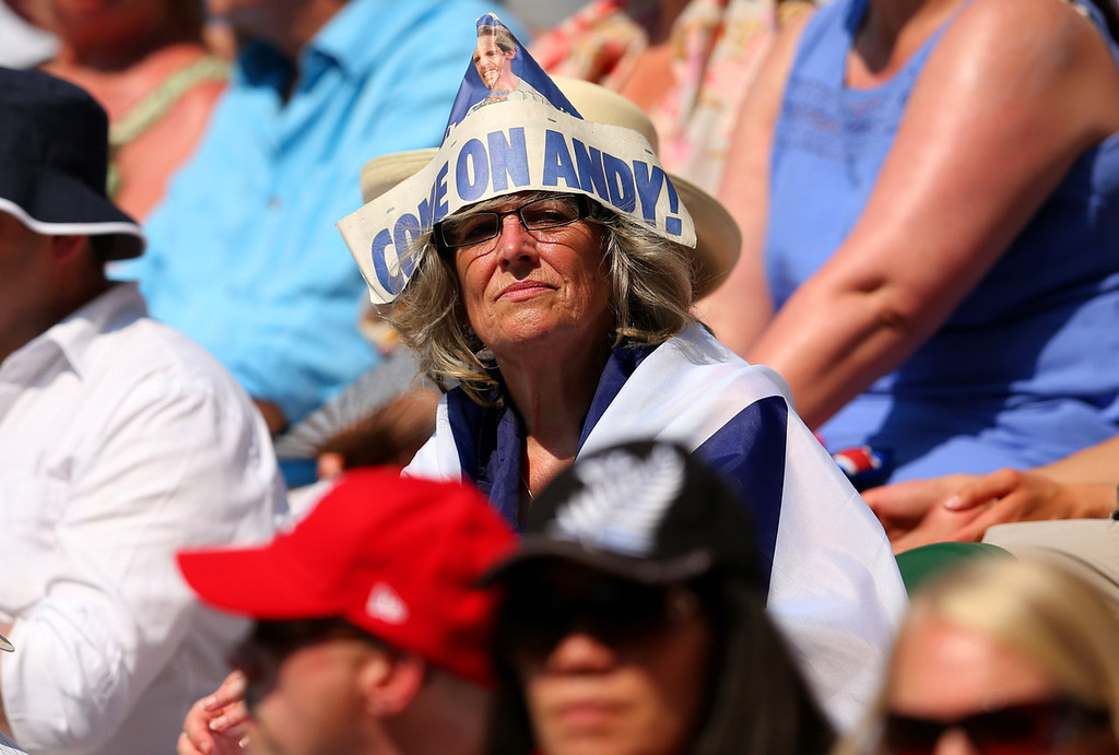 . A spectator on Centre Court wearing a paper hat displaying a message in support of Andy Murray of Great Britain during his Gentlemen\'s Singles Final match against Novak Djokovic of Serbia on day thirteen of the Wimbledon Lawn Tennis Championships at the All England Lawn Tennis and Croquet Club on July 7, 2013 in London, England.  (Photo by Julian Finney/Getty Images)