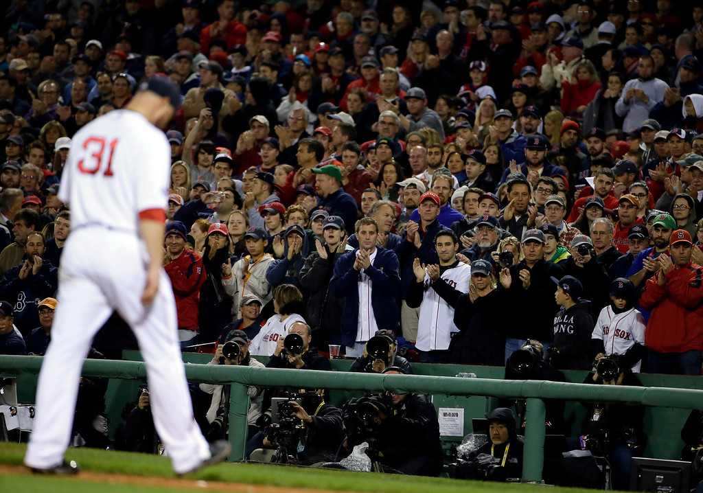 . Fans cheer as Boston Red Sox starting pitcher Jon Lester leaves the game in the middle of the seventh inning during Game 1 of the American League baseball championship series against the Detroit Tigers Saturday, Oct. 12, 2013, in Boston.(AP Photo/Matt Slocum)