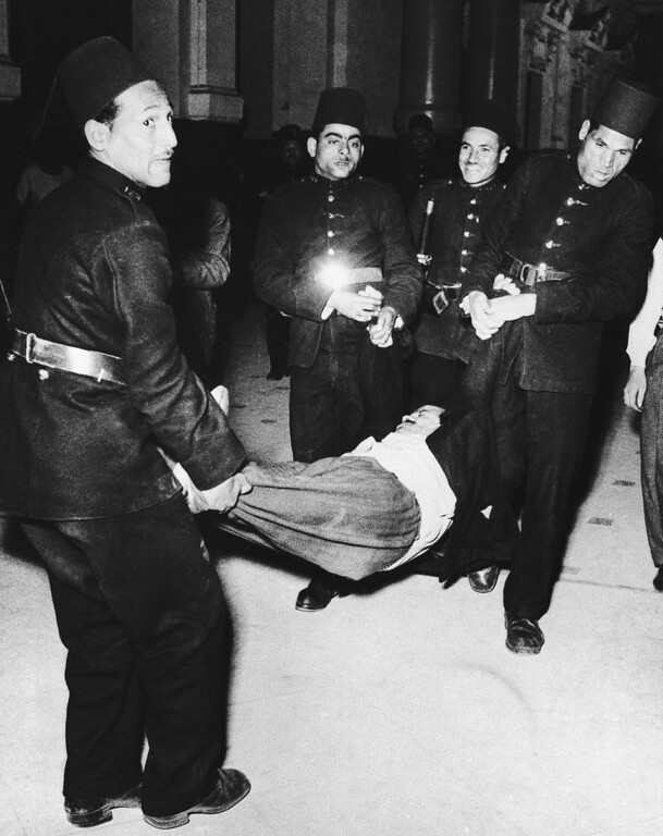 . Abdel Hamid Metwally el Mattat is carried from Cairo court by Egyptian policemen, March 24, 1952 after he had been sentenced to 15 years at hard labor for complicity in last Januaryís riots in the city. The prisoner is alleged to have roamed Cairo in a jeep, distributing rags soaked with petrol to demonstrators. (AP Photo)