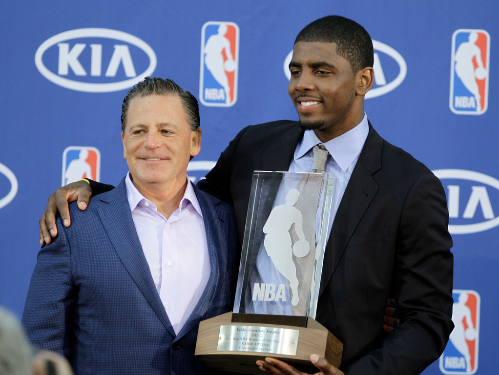 . Cleveland Cavaliers\' Kyrie Irving, right, poses with Cavaliers\' owner Dan Gilbert after Irving was presented with the NBA Rookie of the Year award at the basketball team\'s headquarters in Independence, Ohio Tuesday, May 15, 2012. (AP Photo/Mark Duncan)
