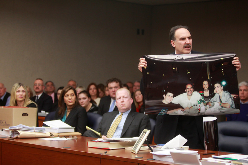""". Fred Seeman holds up a family photo showing his two sons and late wife  Helene Seeman during the sentencing of Amy Locane Bovenizer on Thursday, Feb. 14, 2013 in Somerville, N.J.   Locane-Bovenizer, the former \""""Melrose Place\"""" actress who was driving drunk when her SUV plowed into a car and killed a New Jersey woman has been sentenced to three years in prison.  Locane-Bovenizer faced up to 10 years in prison after a jury in November convicted her of vehicular homicide in the 2010 death of 60-year-old Helene Seeman in Montgomery Township. The judge lowered the maximum sentence citing the hardship on Locane-Bovenizer\'s two children. One has a medical and mental disability.  Locane-Bovenizer\'s blood-alcohol level was nearly three times the legal limit when the crash occurred.  (AP Photo/The Star-Ledger, Patti Sapone, Pool)"""