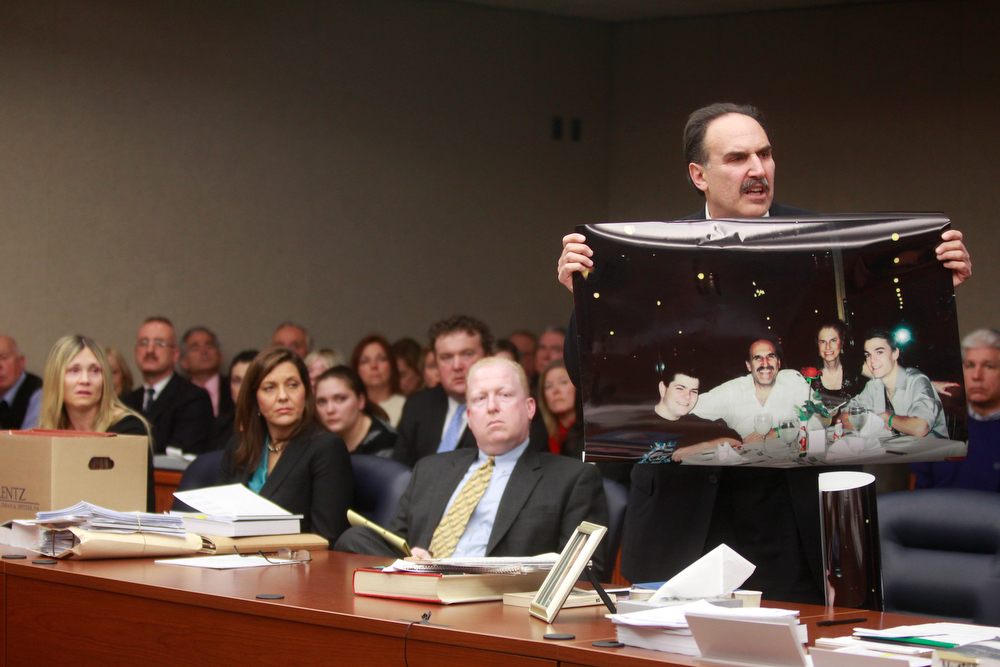 Description of . Fred Seeman holds up a family photo showing his two sons and late wife  Helene Seeman during the sentencing of Amy Locane Bovenizer on Thursday, Feb. 14, 2013 in Somerville, N.J.   Locane-Bovenizer, the former