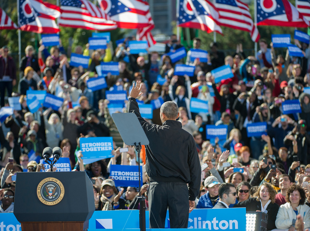 . President Barack Obama waves to the crowd after speaking at a campaign rally for Democratic presidential candidate Hillary Clinton, Friday, Oct. 14, 2016, at the Cleveland Burke Lakefront Airport in Cleveland, Ohio. (AP Photo/Phil Long)