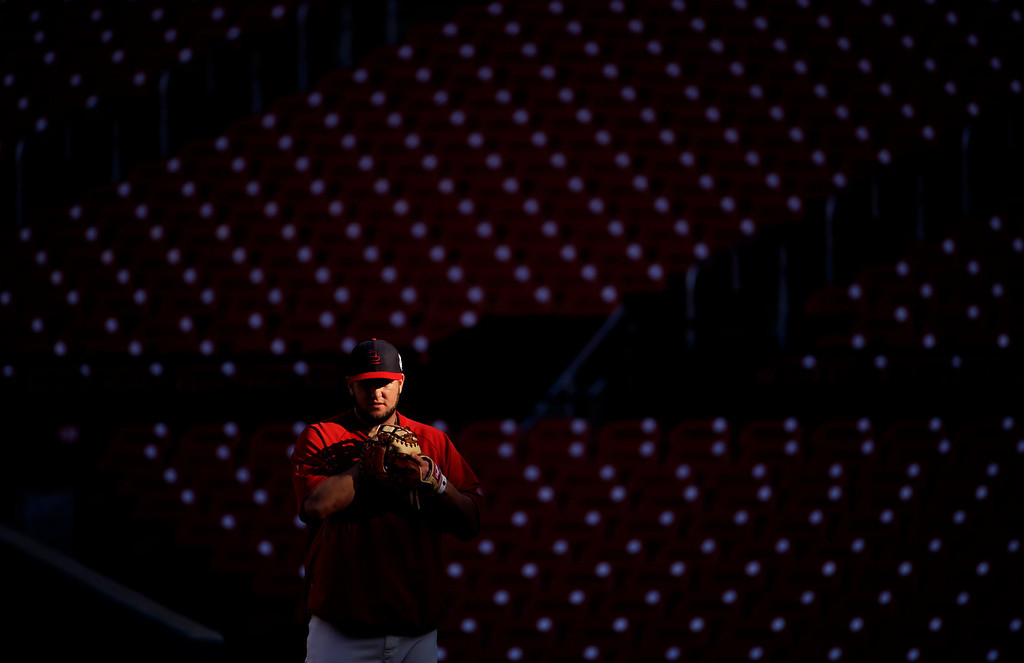 . St. Louis Cardinals\' Matt Adams waits for a throw during practice before Game 3 of baseball\'s World Series against the Boston Red Sox  Saturday, Oct. 26, 2013, in St. Louis. (AP Photo/Matt Slocum)