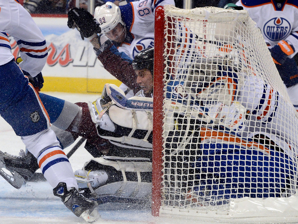 . DENVER, CO. - FEBRUARY 2ND: Patrick Bordeleau, Colorado Avalanche, stuffs Edmonton Oilers goalie, Devan Dubnyk, into his goal on a shot attempt and gets an interference penalty for the play during the first period of play at the Pepsi Center in Denver Colorado, February 2nd, 2013.  (Photo By Andy Cross / The Denver Post)