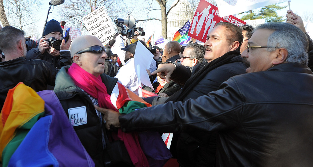 . A same-sex marriage supporter (L) and their opponent (R) scuffle during a demonstration in front of the US Supreme Court on March 26, 2013 in Washington, DC. The US Supreme Court on Tuesday takes up the emotionally charged issue of gay marriage as it considers arguments that it should make history and extend equal rights to same-sex couples. Waving US and rainbow flags, hundreds of gay marriage supporters braved the cold to rally outside the court along with a smaller group of opponents, some pushing strollers. Some slept outside in hopes of witnessing the historic hearing. JEWEL SAMAD/AFP/Getty Images