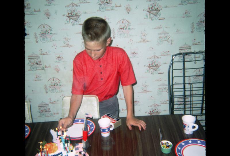robert lighting 11th birthday candles.jpg