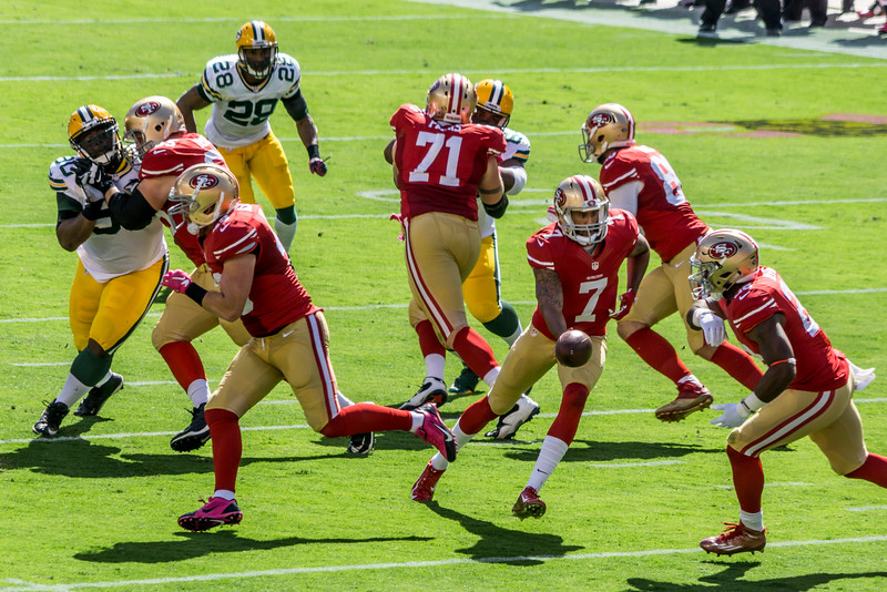 Colin Kaepernick of the San Francisco 49ers hands off to Carlos Hyde during their October 4, 2015, game against the Green Bay Packers.