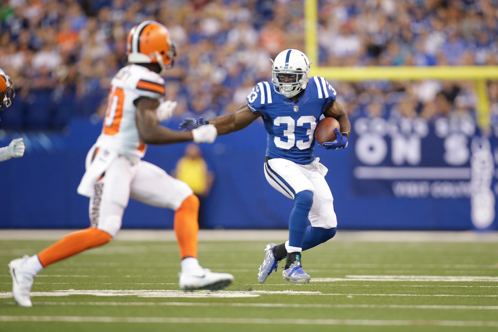 . Indianapolis Colts running back Robert Turbin (33) cuts in front of Cleveland Browns cornerback Jason McCourty (30) during the second half of an NFL football game in Indianapolis, Sunday, Sept. 24, 2017. (AP Photo/AJ Mast)