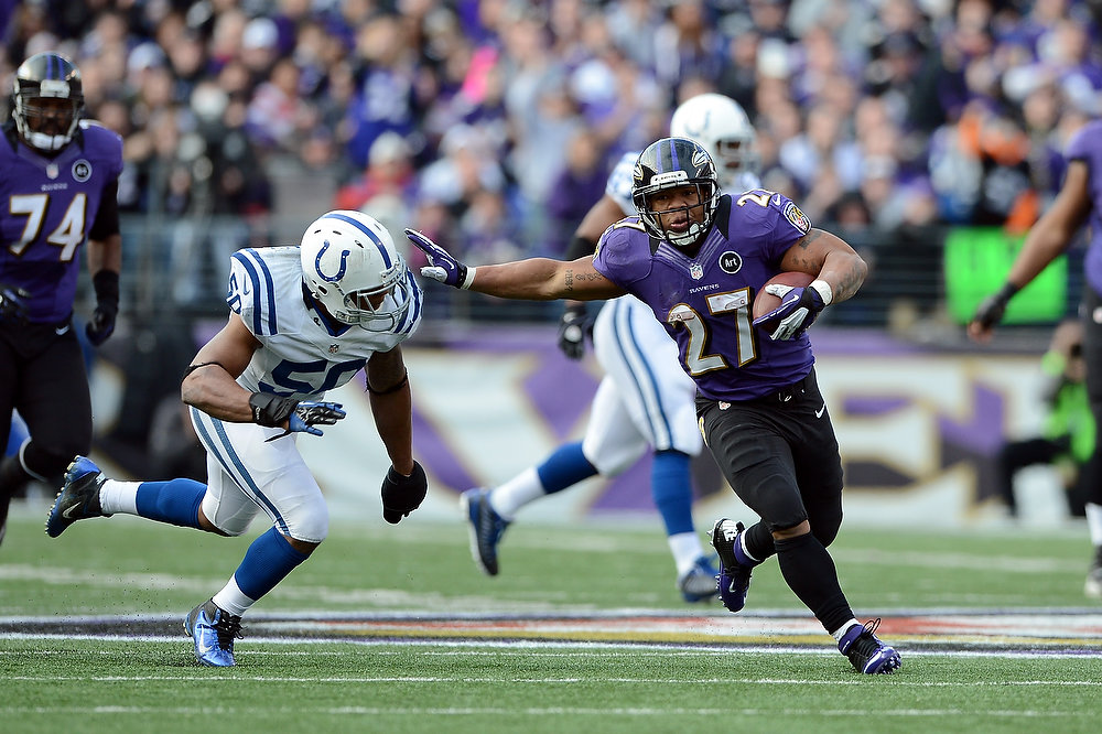 . Ray Rice #27 of the Baltimore Ravens runs the ball against Jerrell Freeman #50 of the Indianapolis Colts during the AFC Wild Card Playoff Game at M&T Bank Stadium on January 6, 2013 in Baltimore, Maryland.  (Photo by Patrick Smith/Getty Images)