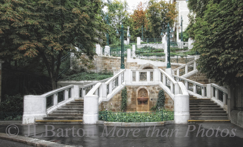 """Die Studlhofstiege 2012-07-23  The Studlhof Steps are a famous Jugendstil architectural feature of Vienna's ninth district.   BUilt around 1910, they became well known as a symbol of autumn after the publication of the eponymous melancholy novel in 1951. """"Wenn die Blätter auf den Stufen liegen herbstlich atmet aus den alten Stiegen was vor Zeiten über sie gegangen... Viel ist hingesunken uns zur Trauer und das Schöne zeigt die kleinste Dauer."""" (rough translation of poetic German) """"When old leaves line the steps, memories of that which travelled over them arise like exhalations.  We mourn the passing of much, and beauty seems to last the least"""" And on another note - why does the picture look like September instead of July?  Because of the rain and because of the chestnut blight. On a sunnier note - it is a beautiful day, so I should go take more pictures."""