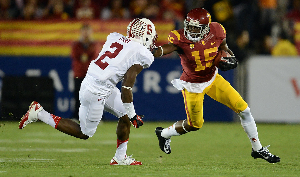 . USC�s Nelson Agholor #15 looks for some running room as Stanford�s Wayne Lyons #2 moves in for the tackle during their game at the Los Angeles Memorial Coliseum Saturday, November 16, 2013. (Photos by Hans Gutknecht/Los Angeles Daily News)