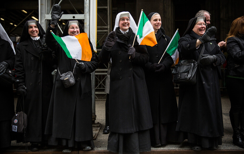. A group of nuns watch the annual St. Patrick\'s Day Parade along Fifth Ave in Manhattan on March 17, 2014 in New York City. (Photo by Andrew Burton/Getty Images)