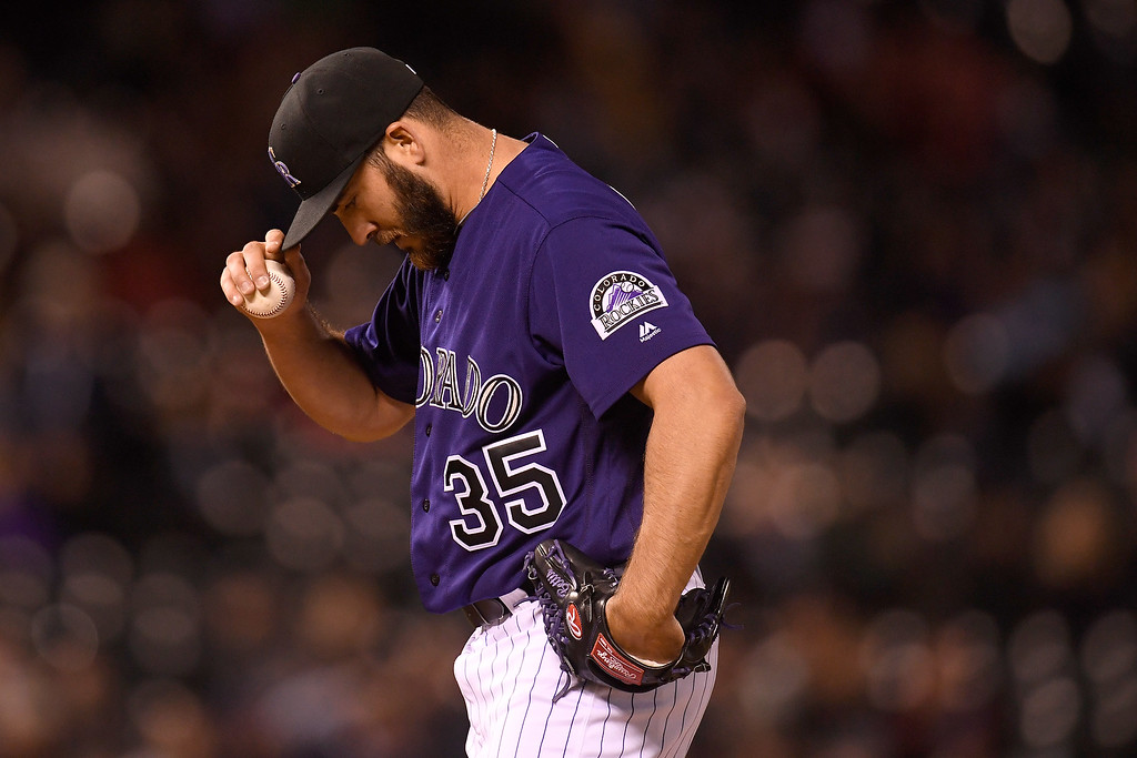 . DENVER, CO - APRIL 25: Chad Bettis (35) of the Colorado Rockies adjusts his cap as he works against the Pittsburgh Pirates during the fifth inning at Coors Field. The Colorado Rockies hosted the Pittsburgh Pirates on Monday, April 25, 2016. (Photo by AAron Ontiveroz/The Denver Post)