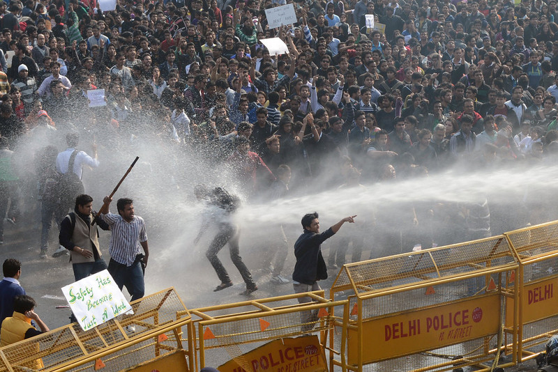 . Demonstrators react as police unleash water cannon during a protest calling for  better safety for women following the rape of a student last week, in front of the Government Secretariat and Presidential Palace in New Delhi on December 22, 2012. Indian police on December 22 baton-charged, tear-gassed and fired water cannon at demonstrators who were demanding better safety for women following the brutal gang-rape of a student last weekend. Thousands of protesters, who rallied at the India Gate monument in the heart of the Indian capital and surged toward the president\'s palace, were calling for stepped-up security for women across the country. RAVEEN DRAN/AFP/Getty Images