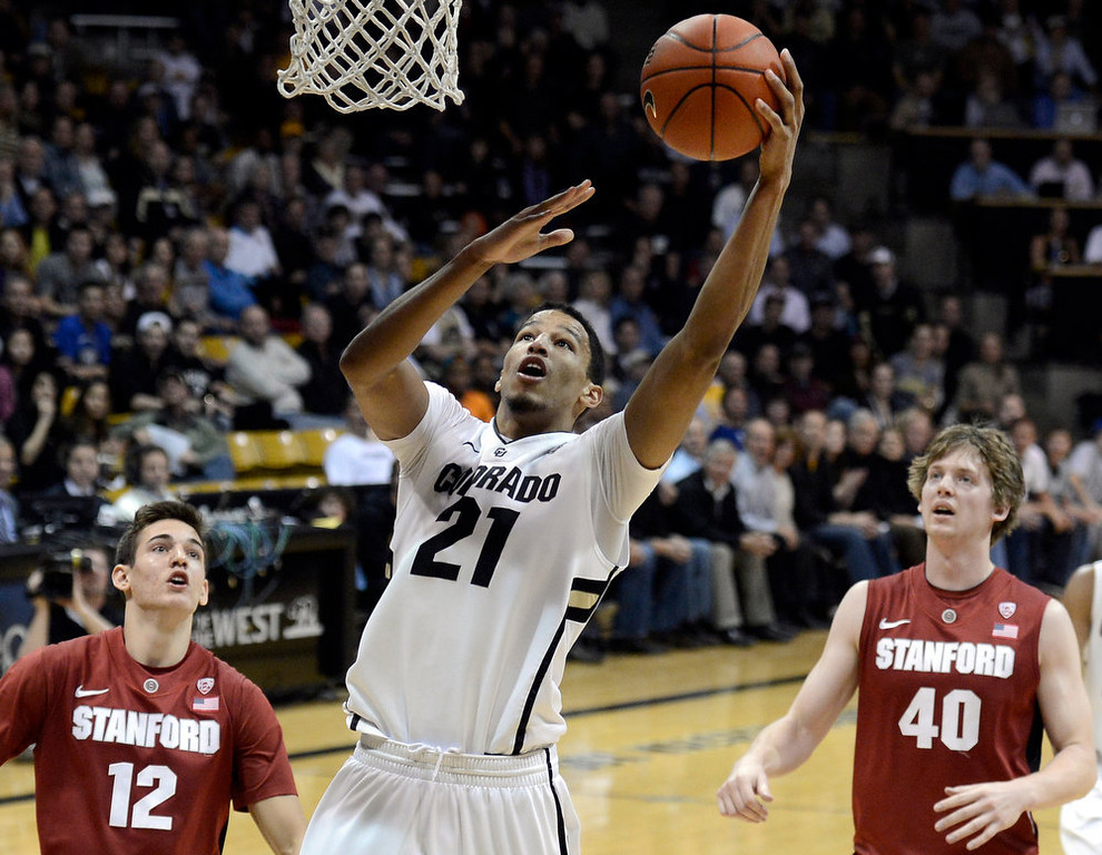 . University of Colorado\'s Andre Roberson goes for a layup over Rosco Allen, No. 12, and John Gage, No. 40, during a game against Stanford on Thursday, Jan. 24, at the Coors Event Center on the CU campus in Boulder.   Jeremy Papasso/ Camera