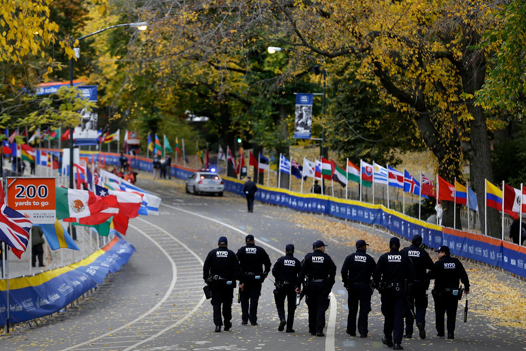 . Counter-terrorism police officers walk the course near the finish line of the 2013 New York City Marathon in New York, Sunday, Nov. 3, 2013. The increased security at the marathon will be most evident near the finish line in Central Park. There will be barricades around the park to limit entry points, bag checks and bomb-sniffing dogs. (AP Photo/Seth Wenig)