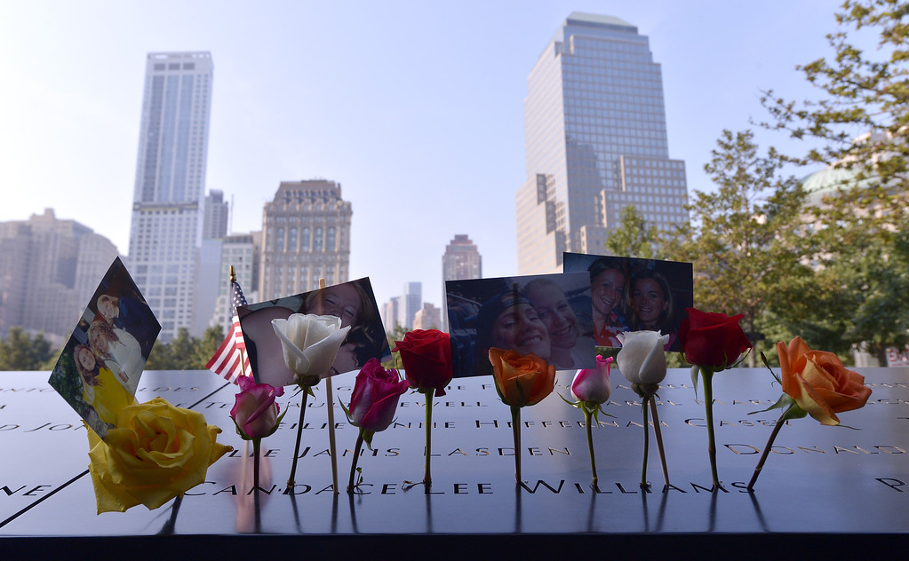 . Flowers and pictures left along the North Pool at the 9/11 Memorial during ceremonies for the twelfth anniversary of the terrorist attacks on lower Manhattan at the World Trade Center site on September 11, 2013 in New York City.(Photo by Justin Lane-Pool/Getty Images)