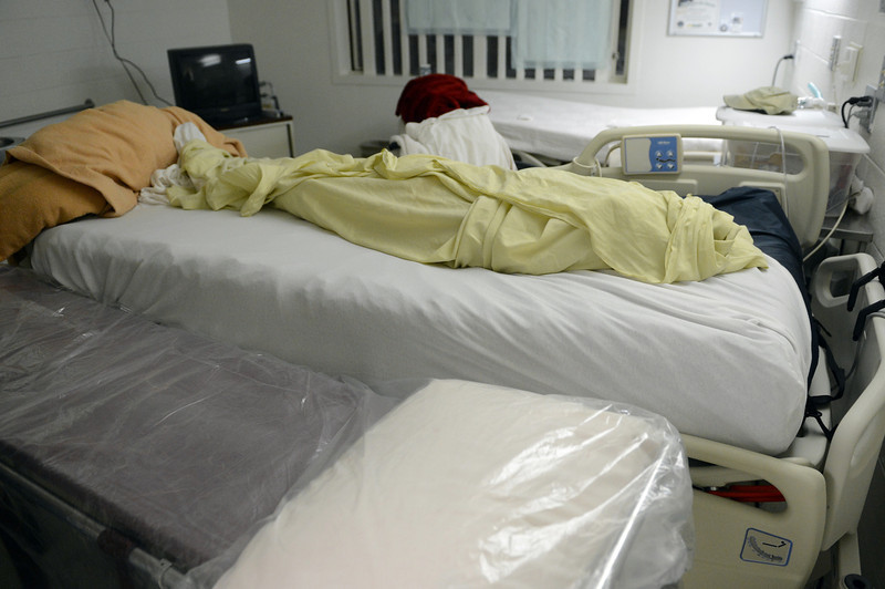 . Robert Bryan\'s body is wrapped in the sheets of his prison bed after he past away on January 6, 2013, at Colorado Territorial Correctional Facility. (Photo By RJ Sangosti/The Denver Post)