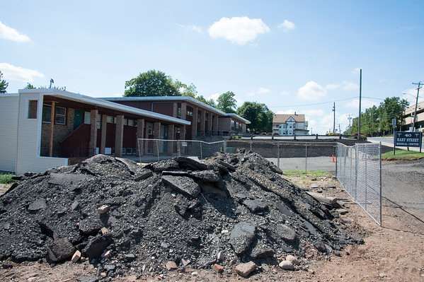 09/03/19 Wesley Bunnell | Staffrr40 Hart St which is under redevelopment has one of the smaller buildings demolished and the parking lot pavement ripped up waiting to be carted away.