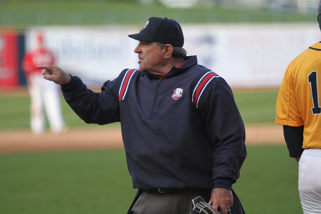 . Michael Johnson - The News-Herald Home Plate Umpire Steve Mellinger points at Mentor coaches for arguing with him during the Mentor vs. Ignatius Baseball game at Classic Park on April 20, 2016. Ignatius defeated Mentor 5-4.